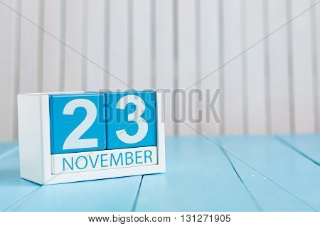 November 23rd. Image of november 23 wooden color calendar on blue background. Autumn day. Empty space for text.