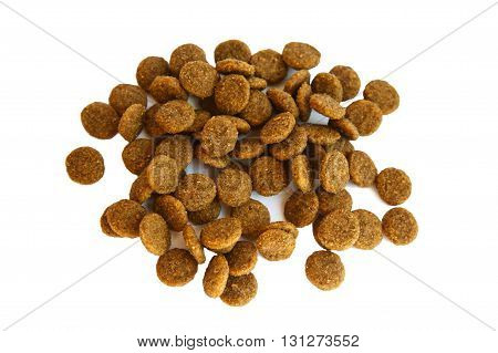 Dry pet food on an isolated background. Granules of good nutrition for dogs and cats. Food for the animals. Brown uniform pieces of dry food.