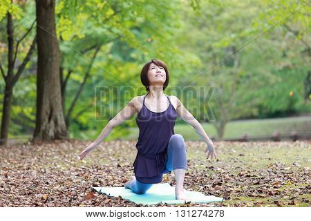 portrait of Japanese woman outside doing workout