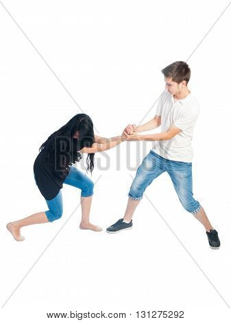 Boy grabbing hard a girl's wrist. Bullying ceoncept on white background