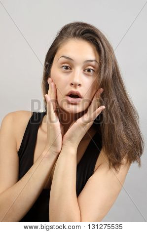 Portrait Of Astonished Brunette Looking At Camera