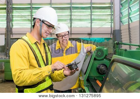 Factory workers discussion inspection report with product and vernier calipers