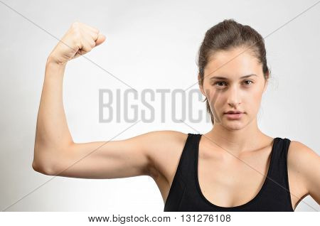 Woman Playfully Shows The Muscles In The Hand