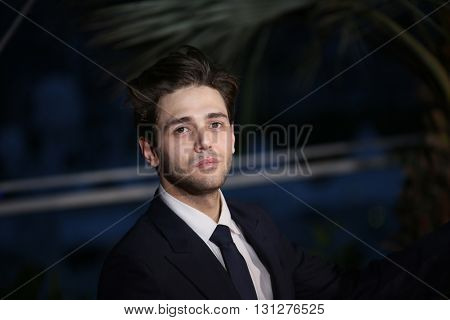 Xavier Dolan poses  the Palme D'Or Winner Photocall during the 69th annual Cannes Film Festival at the Palais des Festivals on May 22, 2016 in Cannes, France.