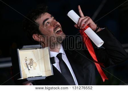 Shahab Hosseini poses  the Palme D'Or Winner Photocall during the 69th annual Cannes Film Festival at the Palais des Festivals on May 22, 2016 in Cannes, France.