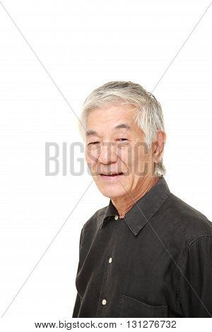 senior Japanese man smiles on white background