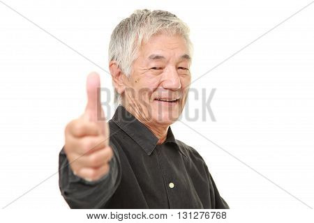 senior Japanese man with thumbs up gesture