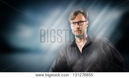 Portrait of a handsome man with glasses in casual clothes