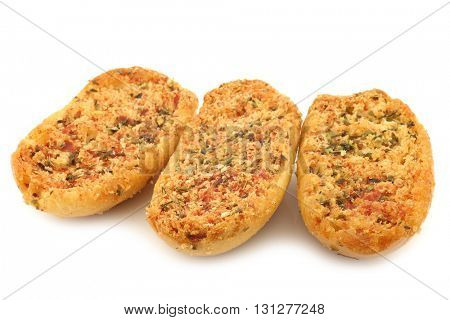 freshly baked Italian bread with garlic and herbs on a white background