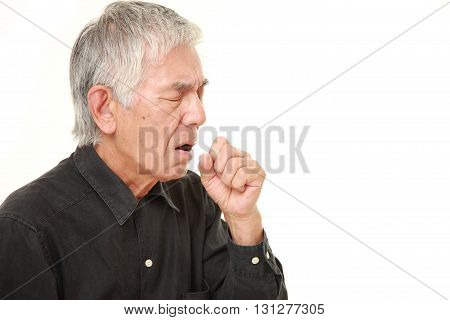 studio shot of senior Japanese man coughing on white background