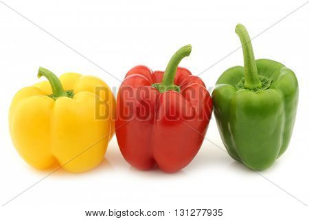 red, green and yellow pepper (capsicum) on a white background