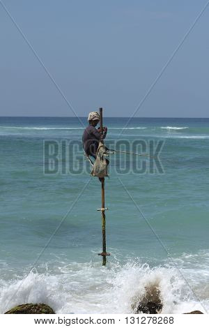 Ahangama, Sri Lanka, March 2014: local fisherman and traditional fishing in Sri Lanka