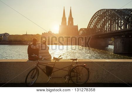 Young romantic couple spending their vacation in Cologne Germany. Dating couple posing near Cologne Cathedral