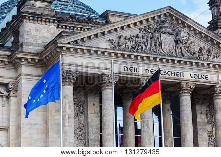 detail of the German Reichstag in Berlin, Germany, with flags