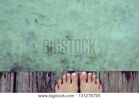 Vacation holidays. Woman feet closeup of girl relaxing on beach on sunbed enjoying sun on sunny summer day. sandy feet on the beach