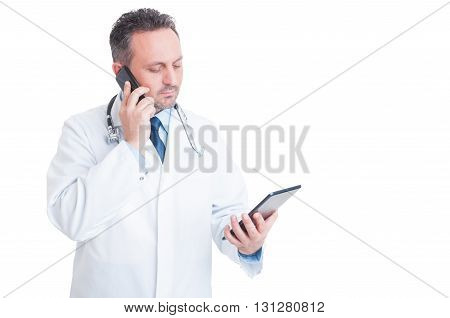 Smart Medic Or Doctor Multitasking With Phone And Tablet
