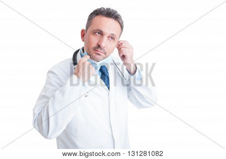 Handsome Medic Removing Protective Surgical Mask