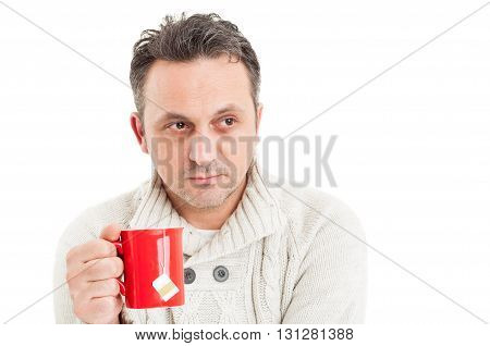 Man Wearing Knitted Pullover Holding A Mug Of Hot Tea