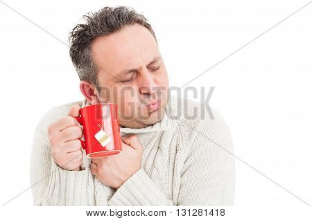 Cold Man Holding Tea Mug And Shivering