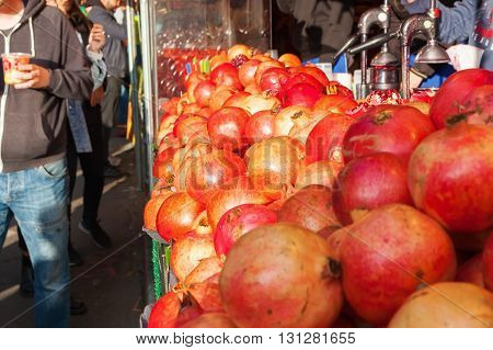 display of a juice stand with fresh pressed pomegranate juice