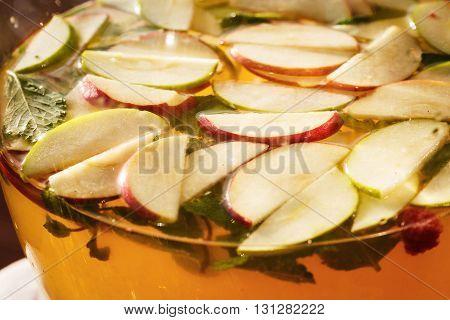 Beautiful transparent glass teapot with fruit herbal tea