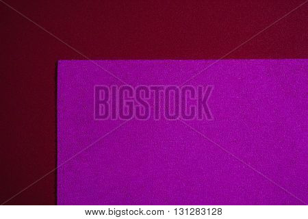 Eva foam ethylene vinyl acetate sponge plush pink surface on red smooth background