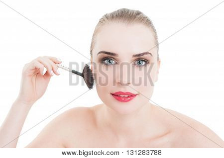 Portrait Of Woman Applying Cosmetics With Brush
