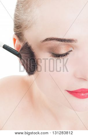 Half Face Of Woman Wearing Make-up And Using Brush