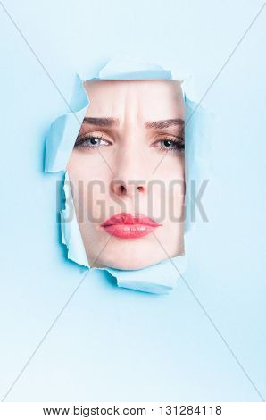 Woman Frown Face  Thru Blue Ripped Board