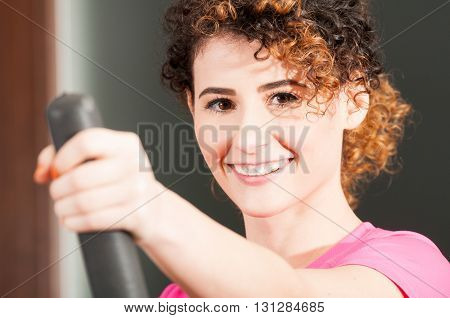 Close-up Of Beautiful Woman Smiling And Exercising On Stepper