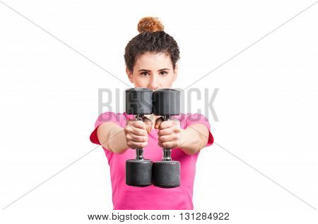Close-up Of Fit, Young Woman Extending Her Arms With Dumbbells