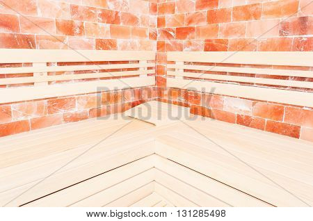 Wooden Bench, Salt Wall And Headrest Support In Sauna
