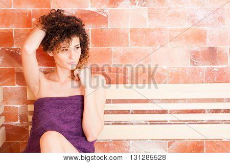 Portrait Of Female Standing In Salt Sauna Room
