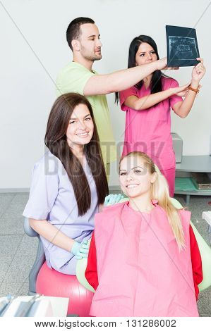 Professional Dentist Team Analyzing An Xray
