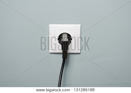 Closeup Of Electric Socket With Black Cable Plugged In