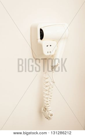 White Dryer Hanging On Wall At Locker Room