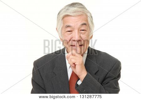 portrait of senior Japanese businessman whith silence gestures on white background