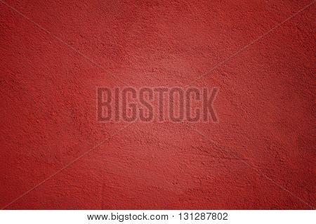 Background Made of Painted Wall in Warm Red Color with Vignette