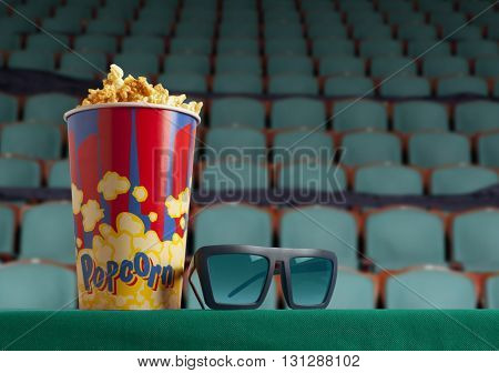 3d glasses and popcorn on green armchair cinema. Blockbuster concept