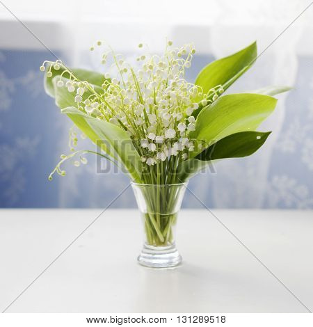 lily of the valley flowers bouquet in vase