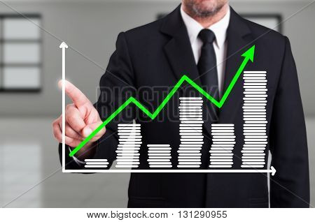 Man With Growth Chart Business Diagram On Digital Screen