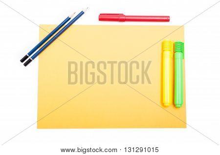 Office Supplies On Yellow Notepad On Organized Desktop