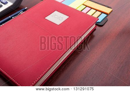 Close-up Of Notebook Planner And Sticky Notes As Pov