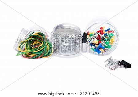 Office Supplies Concept In Plastic Jars Isolated On White