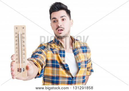 Man In Shirt Holding A Thermometer In His Hand