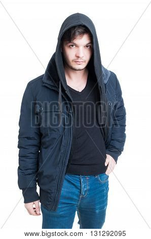 Handsome trendy male wearing hooded sweatshirt black jacket and jeans as stylish clothing concept isolated on white background