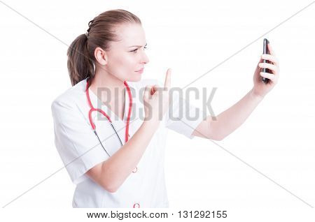 Upset Woman Doctor Showing Middle Finger Over Video Call