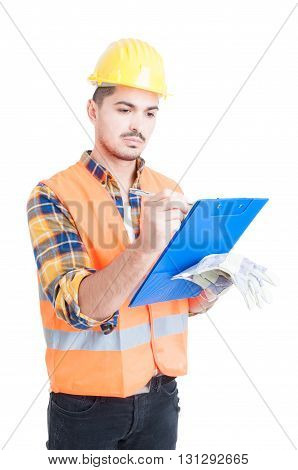 Portrait Of Handsome Engineer Using Clipboard To Write Something