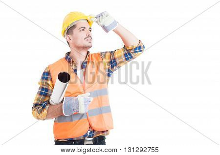 Handsome Engineer Holding A Rolled Paper Plan And Looking Up