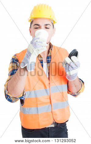 Male Engineer In Workwear Drinking His Morning Coffee